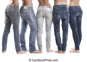 Low Section Of People Wearing Blue Jeans On White Background