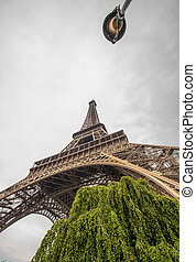 La Tour Eiffel in Paris surrounded by trees in summer