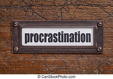 procrastination label - procrastination word - file cabinet...