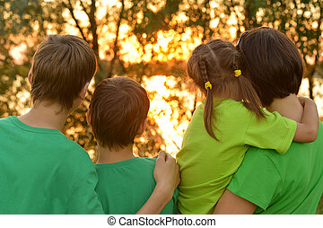 Happy family outdoors,view from the back