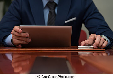 Close-Up Of Businessmen Using Touchpad - Young Businessmen...