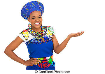 african woman in traditional clothes presenting - gorgeous...