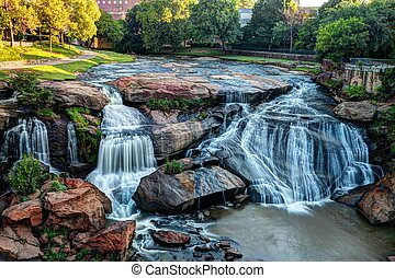 Falls Park On The Reedy River - A gorgeous waterfall flows...