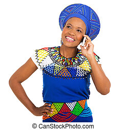 young african woman talking on cell phone isolated on white...