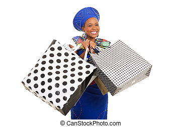 black woman holding shopping bags - excited black woman in...