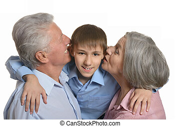 Grandparents kissing grandson - Happy Grandparents kissing...