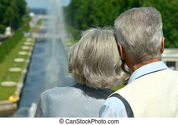 Retired couple outdoors - Back view of retired happy couple...