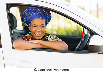 african girl inside her new car