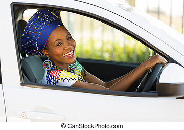 young african woman driving a car - beautiful young african...