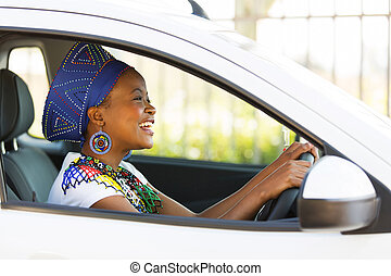 african female driver inside a car - cheerful african female...