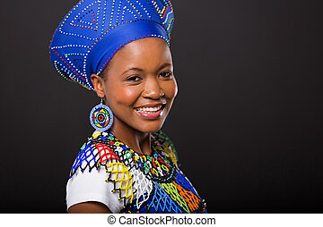 zulu woman in traditional clothes on black background -...