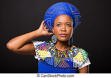 south african woman in traditional attire looking up -...