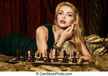 Blond woman playing chess - Portrait of beautiful blond...