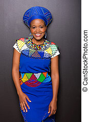 african zulu woman standing against black wall - gorgeous...