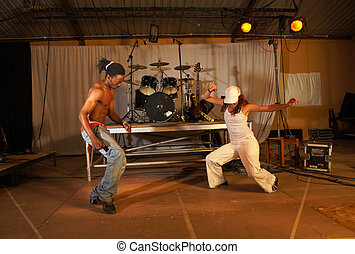 Two freestyle hip-hop dancers a man and a woman at a...