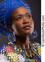 zulu girl looking up - cute african zulu girl in traditional...