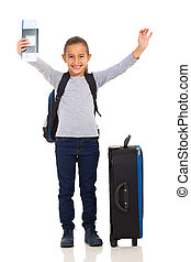 young girl holding boarding pass