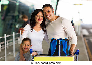 family at airport - portrait of beautiful family at airport