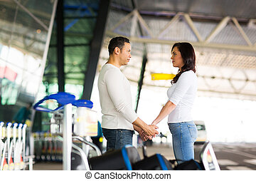couple say good bye at airport - loving couple say good bye...