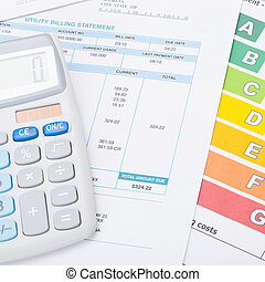Calculator with utility bill and energy rating chart under...