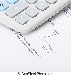Calculator over utility bill under it - 1 to 1 ratio
