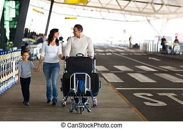 cute family travelling