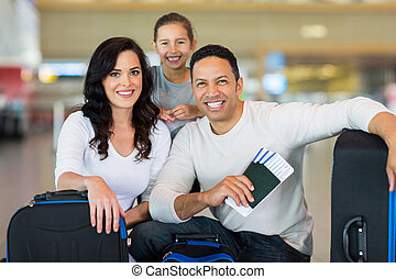 family at airport before boarding - beautiful family at...