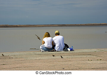 Twain - Man and woman sitting inhe coast taken in Russia