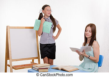 Happy student teacher response - Pupil stands at the...