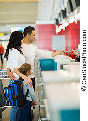 family checking in at airline counter