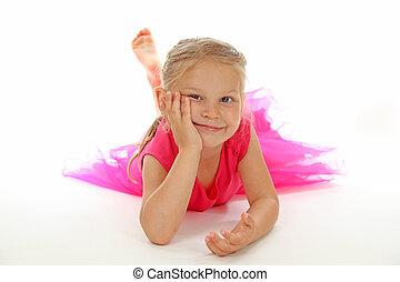 Cute girl in ballerina dress on white background
