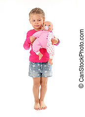 Little girl plays with favourite doll. Isolated over white background