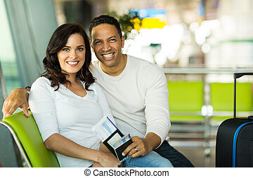 couple waiting for flight at airport - portrait of cute...