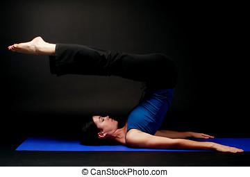 Girl doing pilates exercises in studio