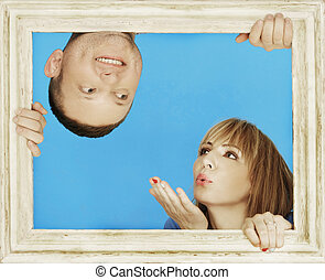 Couple Behind Wooden Frame on Sky Blue Background - Love...