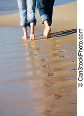 footprints in the sand - footprints left in sand after...