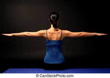 Girl doing pilates exercises in studio