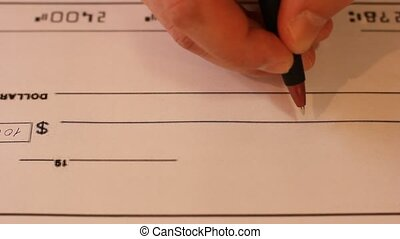 Writing Cheque - Writing a cheque for payment with a...