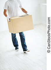 Moving - Man with a box indoors
