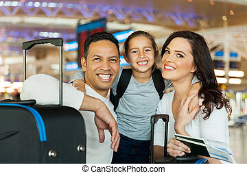 couple with their daughter at airport - portrait of cute...