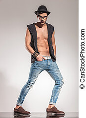 cool fashion man in a dramatic flexed pose
