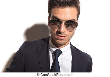 handsome business mans face wearing sunglasses in a closeup...