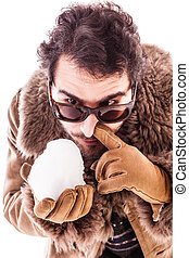 Snorting a snowball - a young man wearing a sheepskin coat...