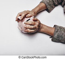 Secure investments - Top view of senior woman hands holding...