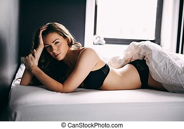 Attractive woman waking up - Portrait of attractive woman...