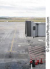 Jet bridge - Unmanned jet bridge with empty airport landing...