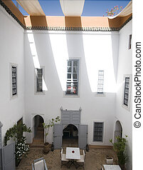 courtyard in riad hotel marrakech morocco - courtyard of a...