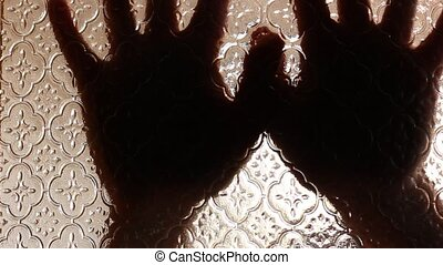 victim - Terrified hands behind glass