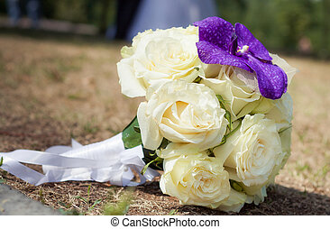 Bridal bouquet made from white roses with lilac orchid
