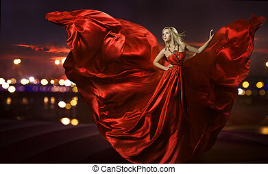 women dancing in silk dress, artistic red blowing gown...